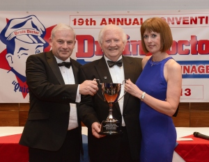 Drain Doctor Plumbing chairman Freddie Mitman (centre) presents Kevin and Dawn Preston with their Franchise of the Year award.